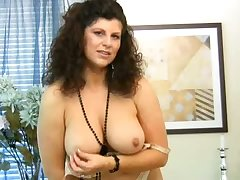Curly mature woman with huge knockers Gilly masturbates herself