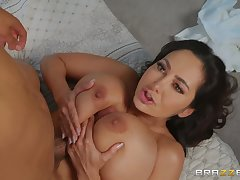 Ava Addams plays with her massive boobs and friend's hard penis