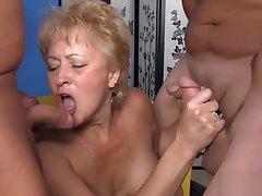 Mature swinger blowing