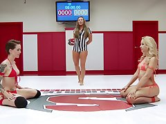 Catfight not far from a MMA ring with pornstars Ariel X and Mistress Kara