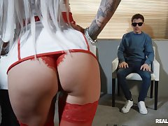 Busty blonde nurse Brooklyn X in red stockings riding a doctor