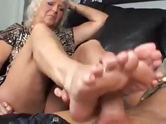 Pretty good granny jerks off a stiff cock with her hooves