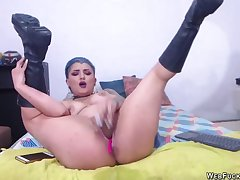 Tattooed camgirl in the matter of knee high boots toying her pussy be suited to fucking bore with other sex toy