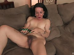 Mature slut Nina Swiss spreads her legs to act with her old cunt