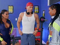Fitness fanatics Luna Star and Kira Noir share a young guy's dick