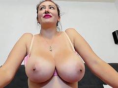 Unpremeditated Amateur webcam model with monster tits teasing topless