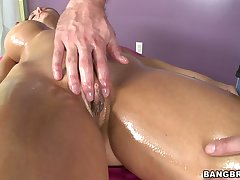 Hot irritant model Ava Addams sucks a dick while being massaged