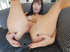 Brunette mature bombshell Alana stuffs her asshole with a huge toy