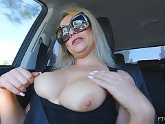 Amateur solo blonde MILF Elle masturbates connected with a car wearing glasses