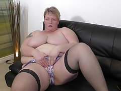 Busty mature amateur BBW Lesley strips and plays with her pussy